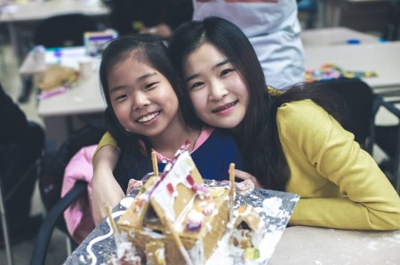 Judy and Mubi with their gingerbread house